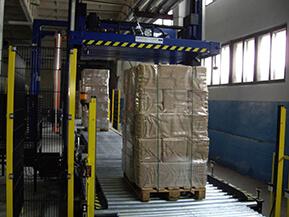 ОАО «Архбум». Поставка автоматической обвязочной машины c поворотным крестом (паллет-пресс), модель КСК-131-26.